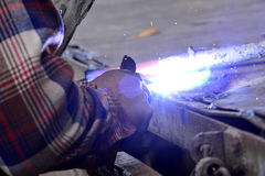Dangerous welding without protective work wear Royalty Free Stock Images