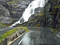 Dangerous wet road. In Trollstigen, a mountain road in Rauma, Norway, part of Norwegian National Road 63 connecting Andalsnes in Rauma and Valldal in Norddal Stock Image