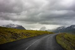 Dangerous winding uphill road in Iceland with a motion blur effect. Dangerous winding uphill road in Iceland with a slight motion blur effect royalty free stock photo