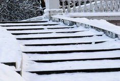 Dangerous winter ladder. Staircase under snow and ice Stock Photography