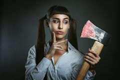 Dangerous woman with axe full of blood Stock Images