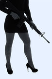 Dangerous woman in black with assault rifle Royalty Free Stock Photos