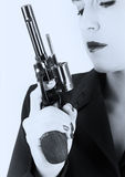 Dangerous woman in black with big handgun Stock Image