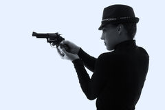 Dangerous woman in black with big handgun Royalty Free Stock Photo