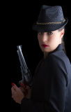 Dangerous woman in black with silver handgun Stock Photos