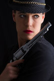 Dangerous woman in black with silver handgun Royalty Free Stock Photography