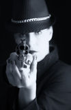 Dangerous woman in black with silver handgun Royalty Free Stock Photo