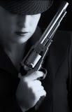 Dangerous woman in black with silver handgun Royalty Free Stock Photo