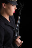 Dangerous woman in black with silver smoking handgun Royalty Free Stock Photos