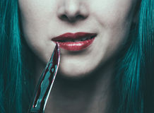 Dangerous woman with knife in blood Royalty Free Stock Photo