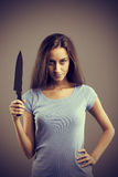Dangerous woman with a knife stock photography