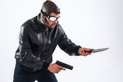 Dangerous young assassin ready for crime Royalty Free Stock Images