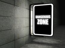 Dangerous zone warning sign at night Royalty Free Stock Photo
