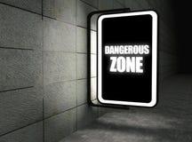 Dangerous zone warning sign at night Royalty Free Stock Photo