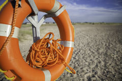 Dangerously tangled rope on a beach lifesaver. Beach lifesaver with dangerously tangled rope. Time would have to be taken to untangle the rope before it could be Stock Images