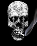 Dangers of smoking. Skull smokes a cigarette with tombstones in the eye sockets, consequences of smoking Stock Images