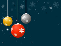 Dangling Christmas Baubles with Snowflake Pattern Royalty Free Stock Photography