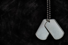 Military dog tags on textured black Royalty Free Stock Images