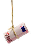 Dangling Euro dollar. Held by a rope isolated on white background royalty free stock photo
