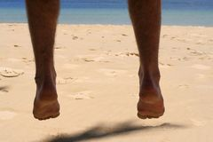 Dangling feet. Image of a persons feet dangling over sand Stock Photography