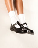 Dangling Girls School Shoes Royalty Free Stock Photos
