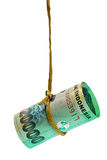 Dangling Indonesian rupiah. Held by a rope isolated on white background Royalty Free Stock Image