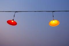 Dangling lamps in a fun task,lamp,Hanging lamp. Dangling lamps in a fun task,lamp Royalty Free Stock Image