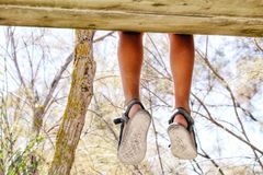 Dangling legs Royalty Free Stock Image