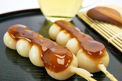 Dango Japanese dessert, served with tea. Royalty Free Stock Photography