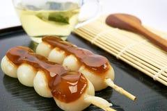 Dango Japanese dessert, served with tea. Dango Japanese dessert, served with tea on white background Stock Photo