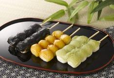 Dango:Japanese dumpling. Three kinds of Dango (Japanese dumpling) on black tray Royalty Free Stock Photos