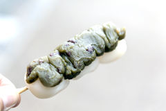 Dango - Japanese rice dumpling made of green tea and red bean Stock Photo