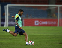 Dani Alves. KUALA LUMPUR - AUGUST 09: Barcelona Football Club player Dani Alves lines up to kick the ball during training session at the Bukit Jalil National Royalty Free Stock Image