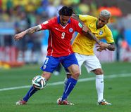 Dani Alves and  Mauricio Pinilla Coupe du Monde 2014 Royalty Free Stock Images