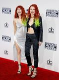 Dani Thorne and Bella Thorne. At the 2016 American Music Awards held at the Microsoft Theater in Los Angeles, USA on November 20, 2016 stock photo