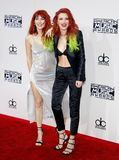 Dani Thorne and Bella Thorne. At the 2016 American Music Awards held at the Microsoft Theater in Los Angeles, USA on November 20, 2016 stock photos