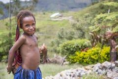 Dani tribe girl. Baliem Valley, West Papua, Indonesia, February 15th, 2016: Dani tribe girl royalty free stock photo
