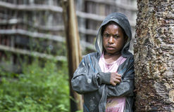 Dani tribe girl in Baliem Valley. Baliem Valley, West Papua, Indonesia, February 12th, 2016: Dani tribe girl in Baliem Valley in western clothing royalty free stock photography