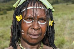 Dani tribes woman at the annual Baliem Valley Festival. Baliem Valley, West Papua/Indonesia - August 9, 2016: Portrait of a Dani tribes woman at the annual stock photo