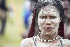 Dani tribes woman at the annual Baliem Valley Festival. Baliem Valley, West Papua/Indonesia - August 9, 2016: Portrait of a Dani tribes woman at the annual royalty free stock photos