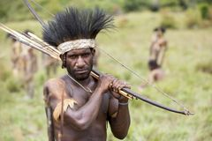 Dani tribesman at the annual Baliem Valley Festival. Baliem Valley, West Papua/Indonesia - August 9, 2016: Portrait of a Dani tribesman at the annual Baliem stock photography