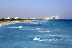Dania Beach, Port Everglades. Beautiful blue coast water and beach leading to the entrance of Port Everglades with buildings, foliage, cruise and cargo ships in Stock Image