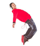 Danicing to the music. Young asian man dancing with stylish clothes. Isolated over white Stock Photography