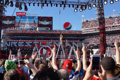 Daniel Bryan celebrates with yes chant with fans on top of ladde. SANTA CLARA - MARCH 29: Daniel Bryan celebrates with yes chant with fans on top of ladder Royalty Free Stock Photos