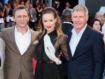 Daniel Craig, Harrison Ford, Olivia Wilde stockfotos