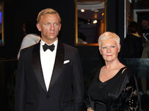 Daniel Craig and Judy Dench. Wax statues at the famous Madame Tussaud's museum in London to celebrate the movie 007 - Quantum of Solace Royalty Free Stock Images