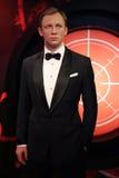 Daniel Craig som för James Bond för medel 007 statyn vax Arkivbild