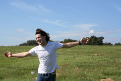 Daniel ~Freedom~. Photo of a young man standing in a field with open arms Stock Image