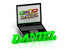DANIEL- Name and Family bright letters near Notebook Stock Images