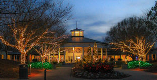 Daniel Stowe Botanical - Christmas 1. Entrance to the Daniel Stowe Botanical Garden in Belmont NC decorated with Christmas lights at dusk stock photography